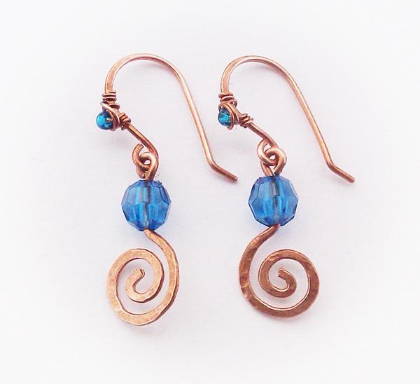Lied van Lir, kleine spiralen en zeeblauwe kralen