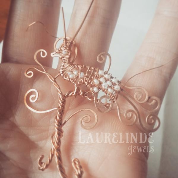 tree of life en een wirewrapped sierlijke pauw