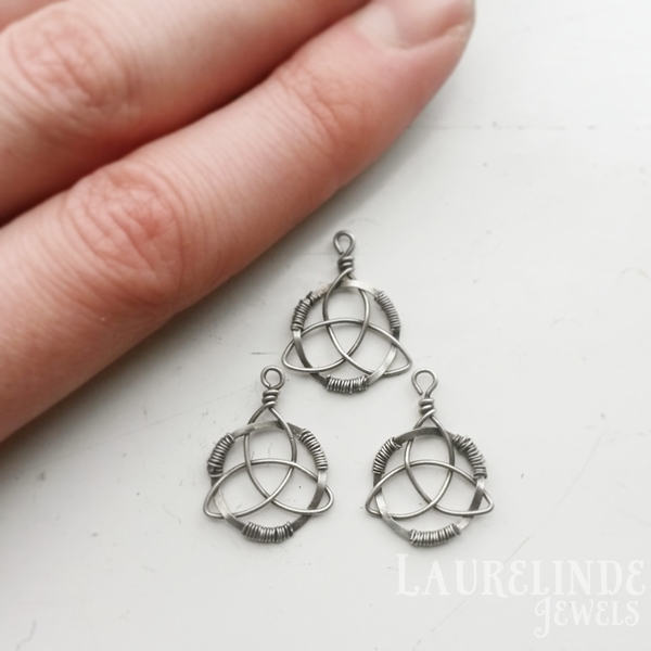 three tiny silver triquetra pendants