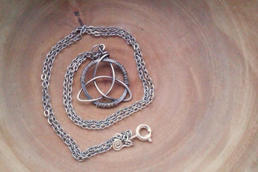 hand woven triquetra pendant